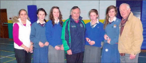 James Moynihan Chairman of the County Board presenting Limerick's desmond college camogie team their award