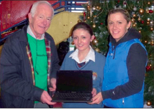 Winner of a laptop at the sports pitch draw 2012