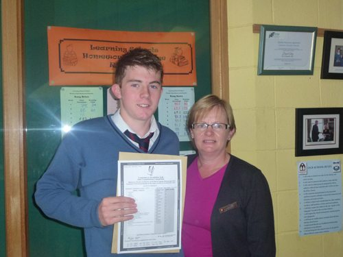 Student proudly receives Junior Certificate Results at Desmond College