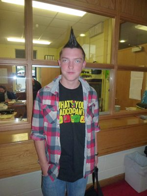Student taking part in the Mad Hair Day for Charity in Desmond College