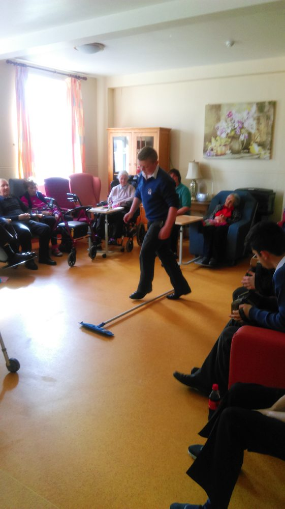Music Students volunteering at the nursing home by Entertaining them with some music, song and dance