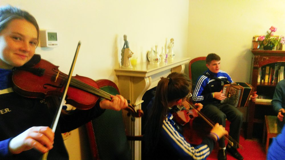 Enjoying Playing the Violin during Music Class in Desmond College
