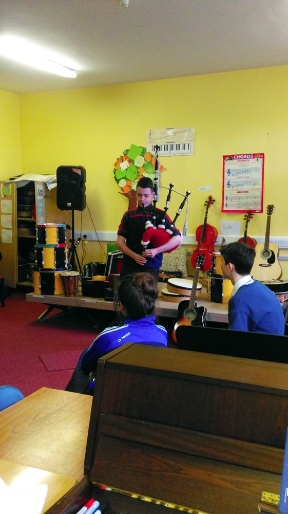 Playing Bag Pipes during Music Class in Desmond College