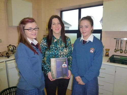 Desmond College students who participated in Neven Maguire's cooking demonstration present his book to their Home Economics teacher