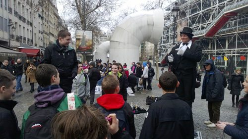 Street Performer entertaining Desmond College students in Paris