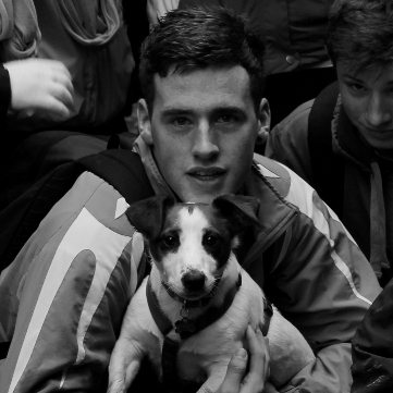 Desmond College student with their class mascot, Kirby the dog, on their Walk the School Day Charity Event