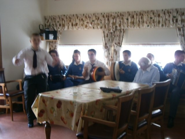 Desmond College Trad Group and Transition Year Students Celebrate Positive Aging Week with Residents at St. Ita's Nursing Home