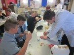 Desmond College Young Scientist Students Explaining Science Experiments to Ashford National School Students