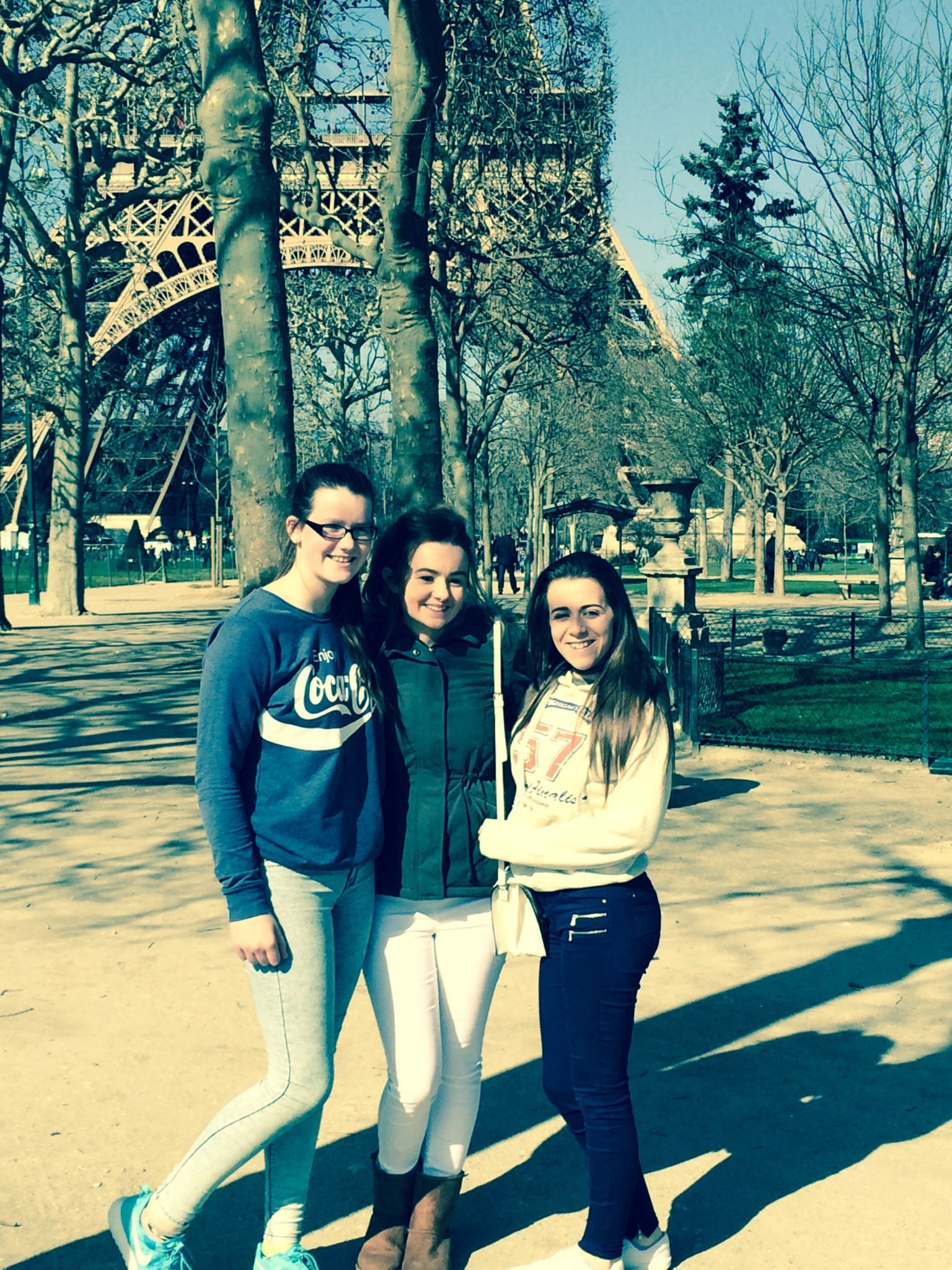 Aoife Corbett, Alice Duffy and Rhea Crowley about to climb the Eiffel Tower