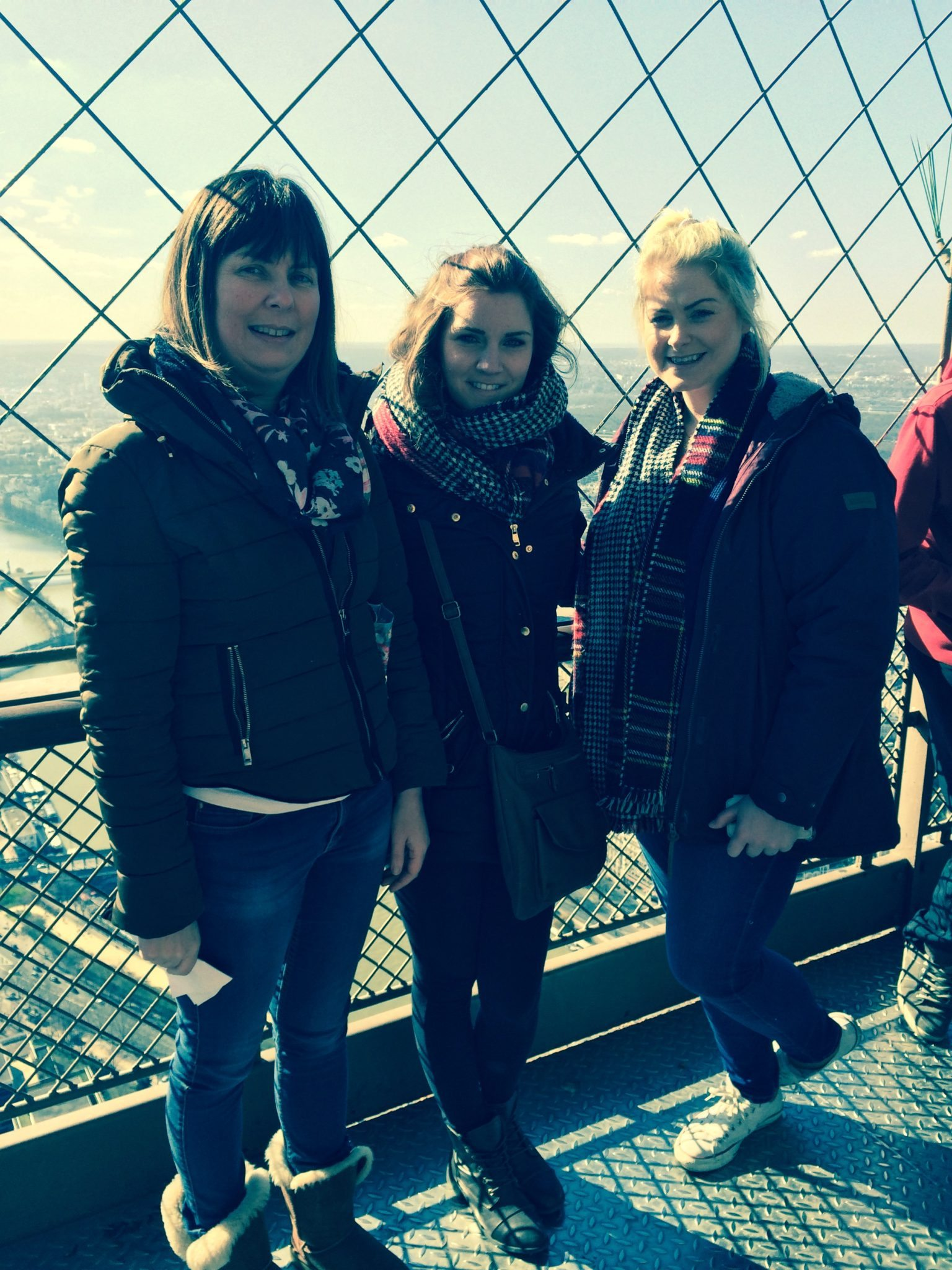 Ms Cregan, Ms Nicholas and Ms Ryan enjoy the view on the Eiffel Tower