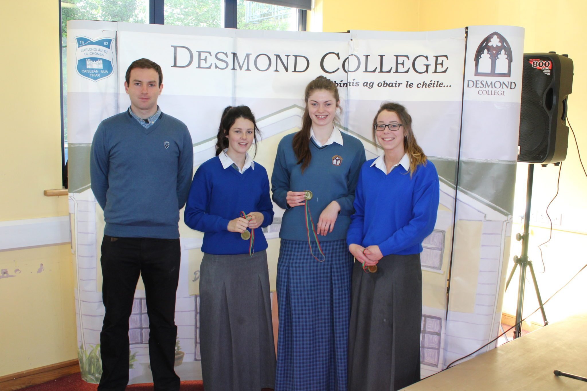 Desmond College Student Awards: May 2015: SPORTS AWARDS Fifth year : Mr Bourke with Leah Kelly, Nell Fox and Kiara Carroll