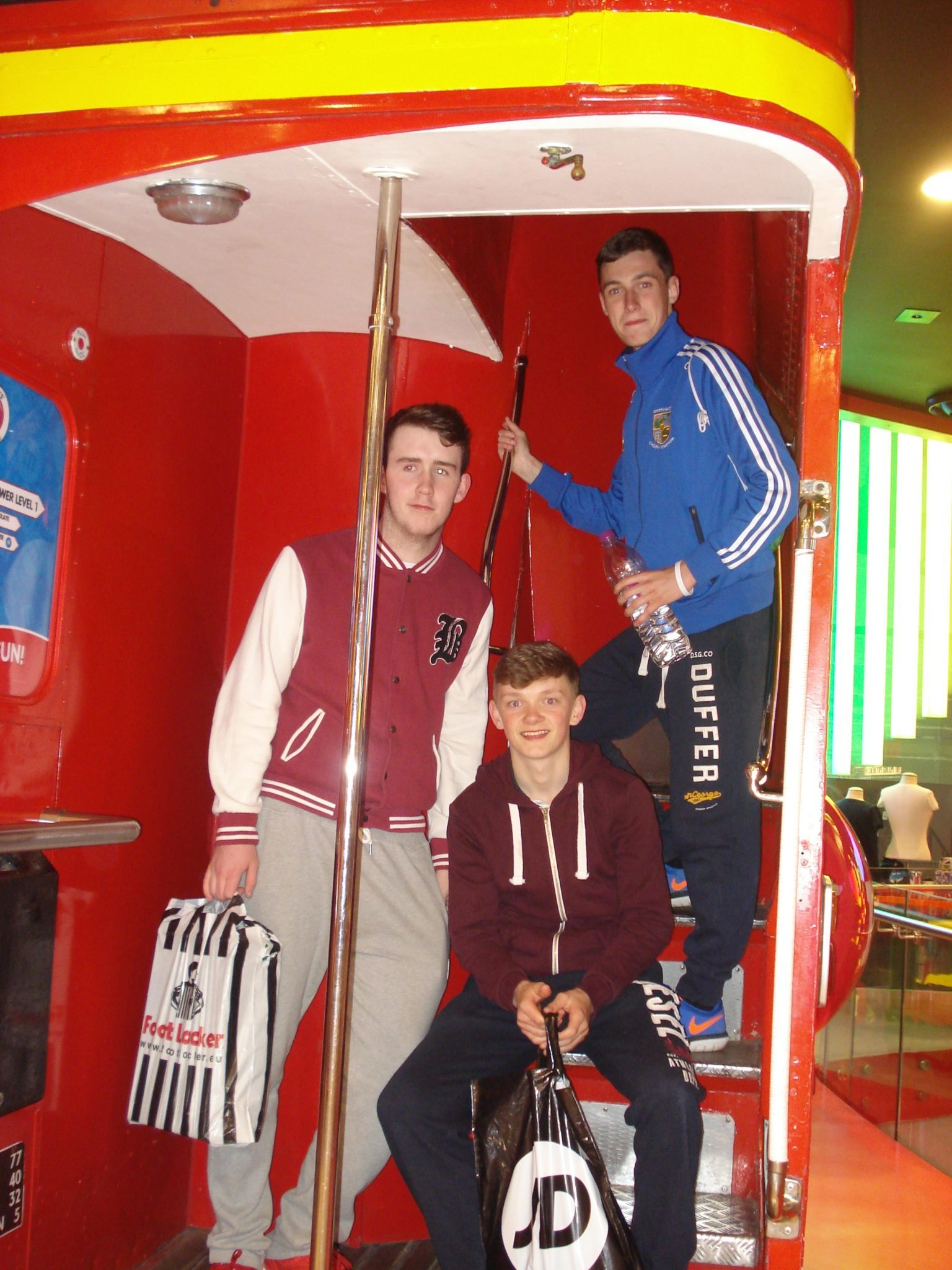 Liam Dowling, John McCoy and conor Kennedy relax after a spot of shopping