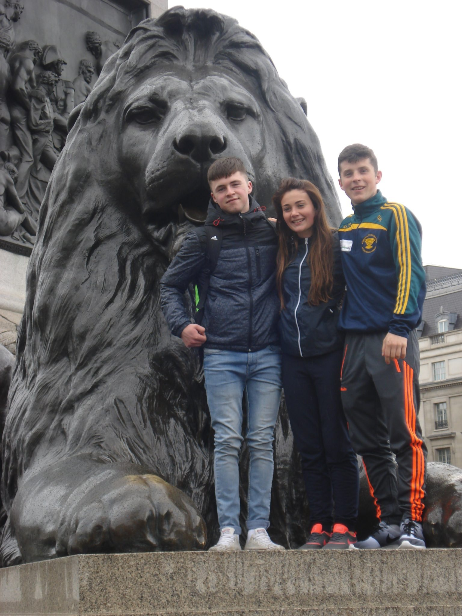 desmond college students Eoin Considine, Emma Herbert and Diarmuid Curtin pictured beside one of the lions at trafalgar square london england on their school trip for ty students april 2015