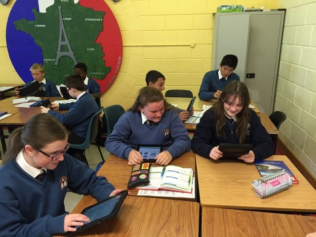 Some of the First Years explore their iPads in French Class