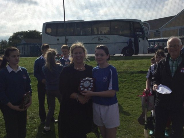 Captain Orla Kenny from Raheenagh National School receives trophy from Vourneen Gavin Barry after leading her team to victory in the primary school camogie blitz hosted by Desmond Colllege