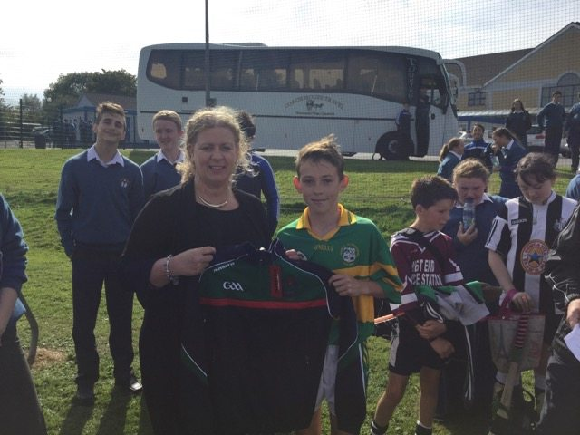 Templeglantine National School Student receives a Desmond college Half Zip from Vourneen Gavin Barry after being awarded hurler of the blitz