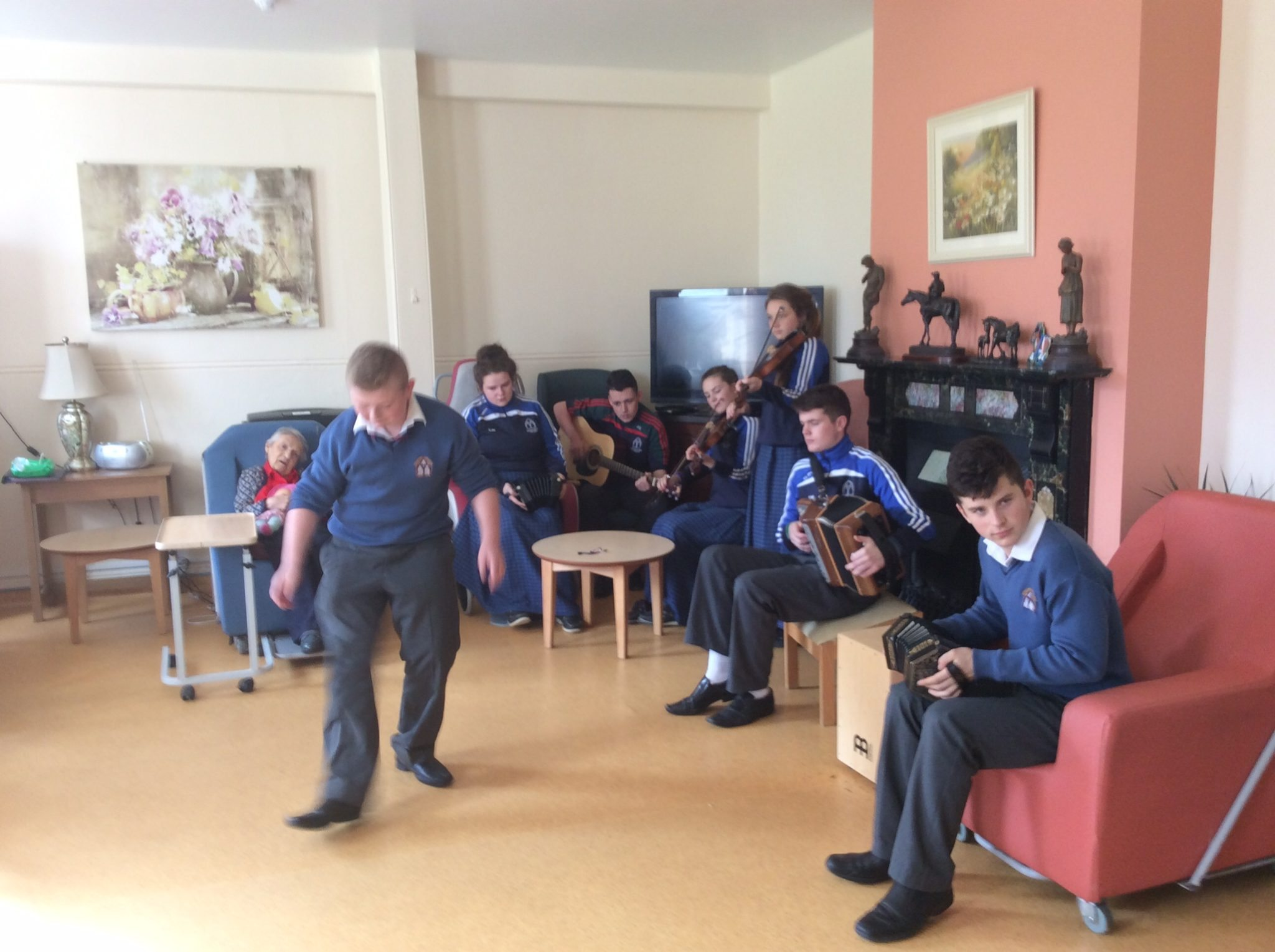 2015 October: Desmond College student takes to the floor, with music by the Trad Group, to entertain at Positive Aging Week