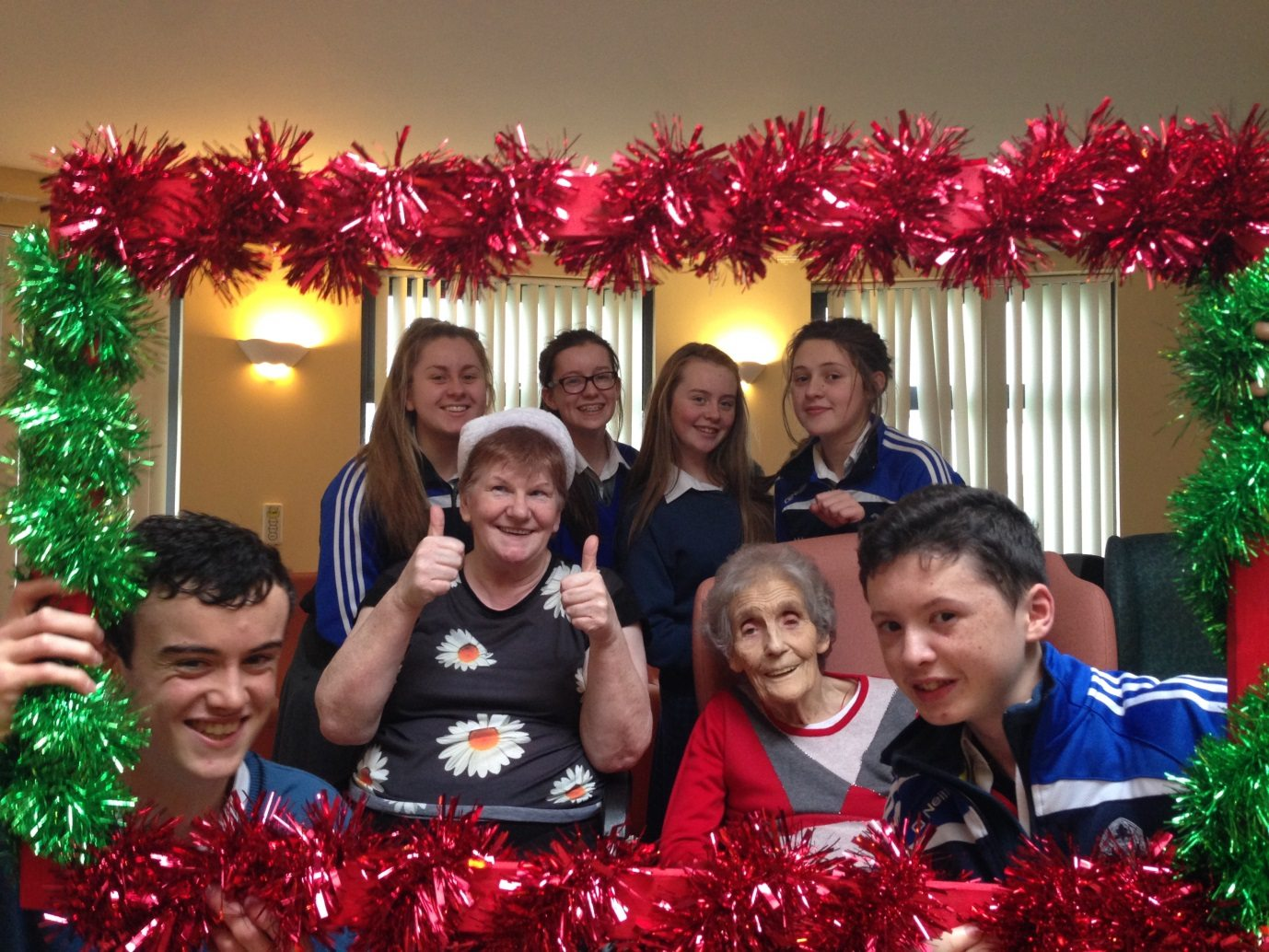 Desmond College Students Singing Christmas Carols for the Residents of St. Itas