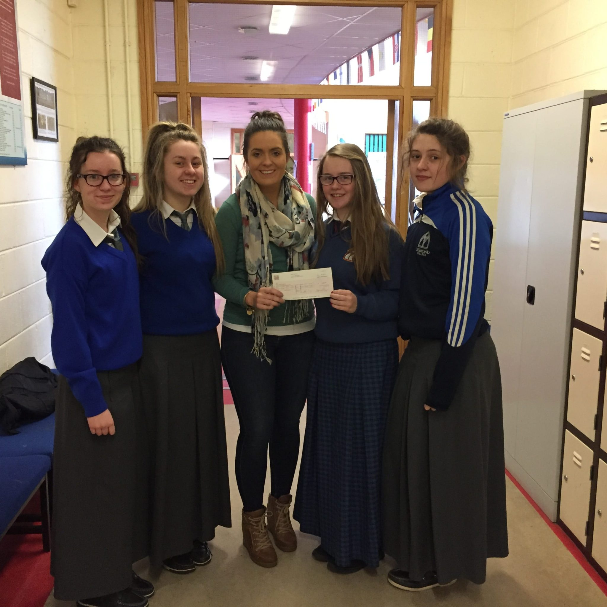 Feb 2016: Desmond College TY students who received a cheque from Tesco for their Hope Foundation immersion programme