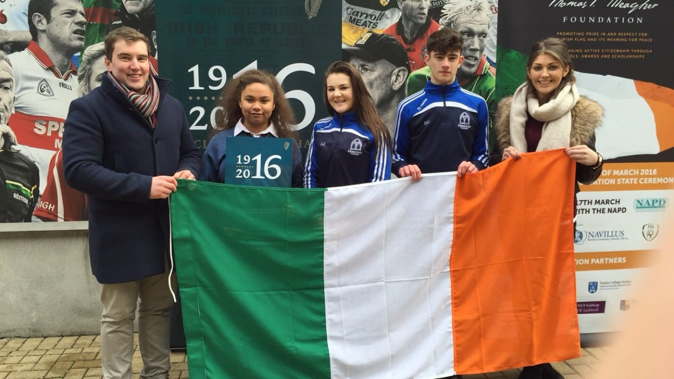March 2016: Mr Kelly and Ms Hennessy with students Latina Massey, Laoise Curtin and Darragh Collins collecting The Flag at the 1916 Commemoration Service in Croke Park