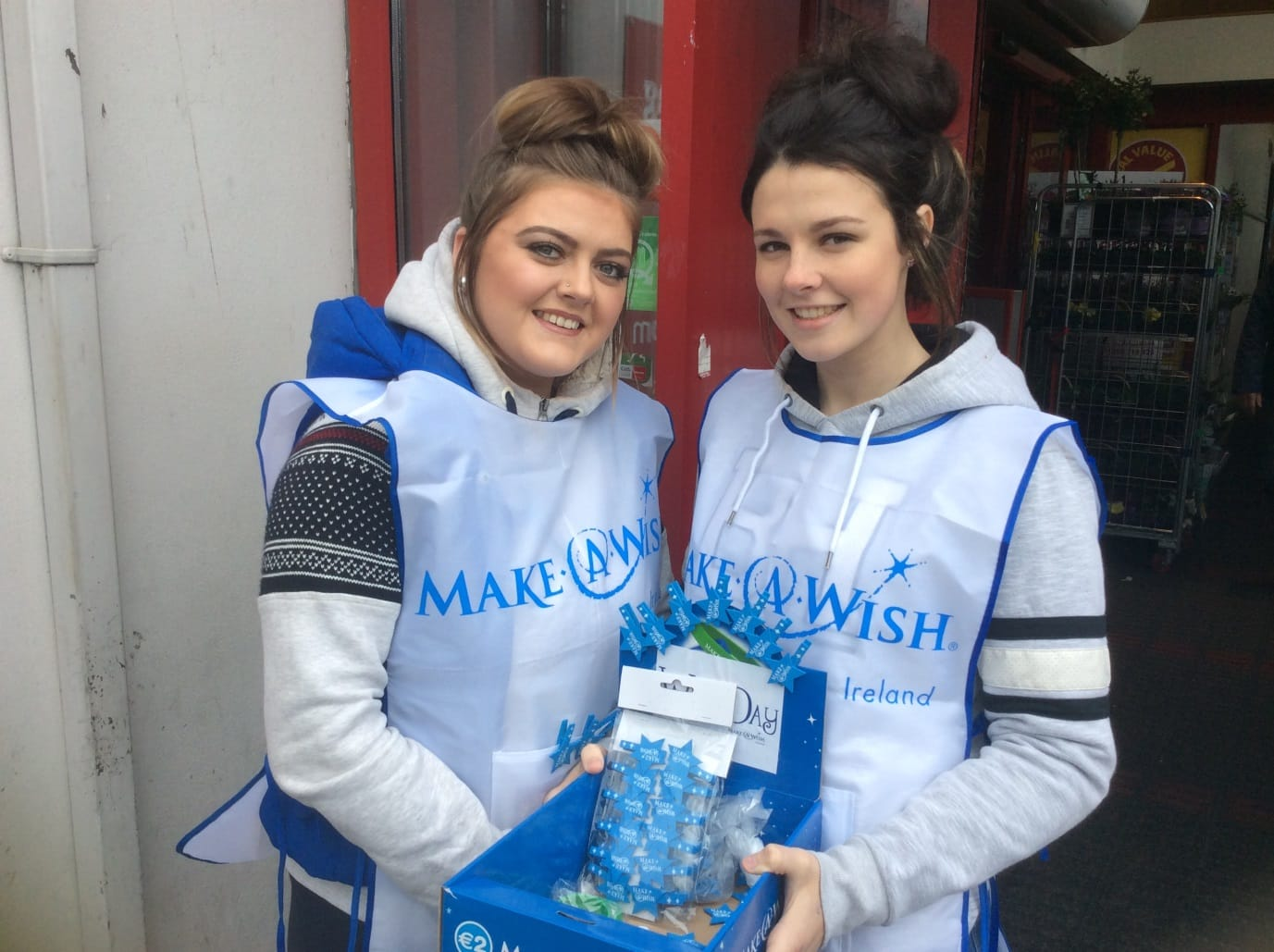 2016 April: Desmond College students Nikita Harnett and Leah Kelly, collecting in Newcastle West Town Center for Make a Wish Foundation