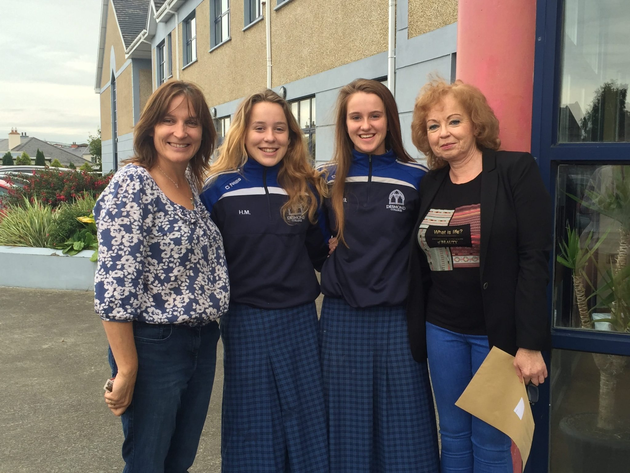 Sept 2016: Hannah McMahon and Roz Barrett pictured with both their mums after receiving their Junior Certificate Results outside Desmond College Post Primary School Limerick
