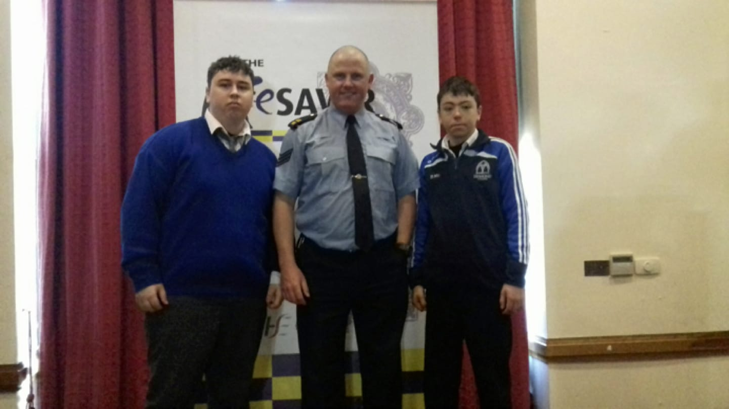 Nov 2016: Sergeant Tony Miniter, co-ordinator of the RSA Lifesaver Course, picturerd with two Desmond College Post Primary School students