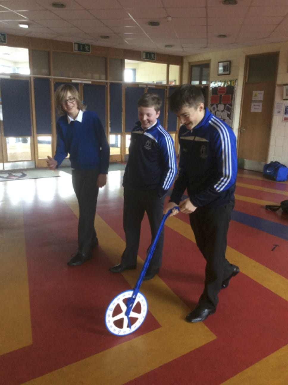 Jan 2017: Desmond College Students using the trundle wheel to-measure-the-area-of-the-school