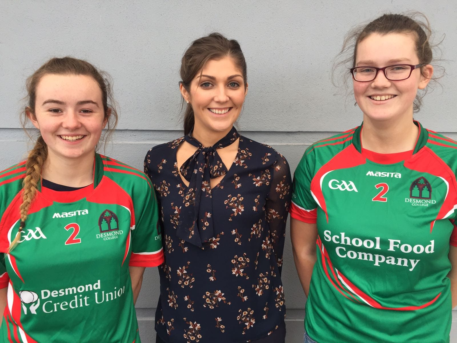 2017 Feb: Desmond College sports students modelling the fabulous jerseys sponsored by The School Food Company with Teacher and Trainer Ms Marie Hennessy