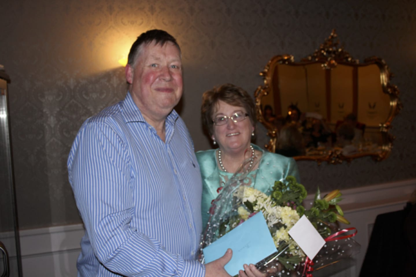 Feb 2017: Donal Enright presenting Bernie Flynn with a Bouquet of flowers at her recent Retirement Party