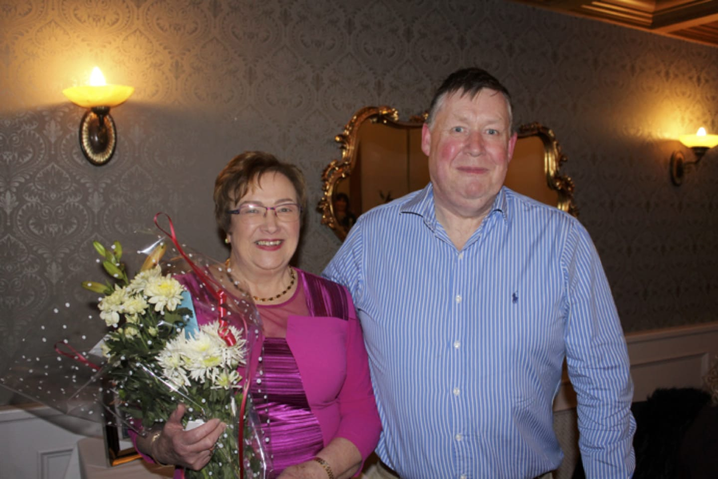 Feb 2017: Donal Enright presenting Carmel Harnett with a Bouquet of flowers at her recent Retirement Party