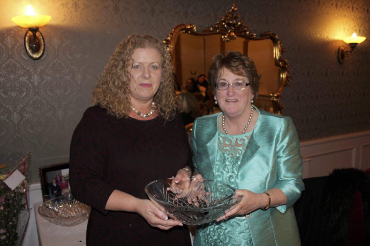 Feb 2017: Bernie Flynn being presented with some Waterford Crystal from Principal Vourneen Gavin Barry at her Retirement Party in the Devon Inn