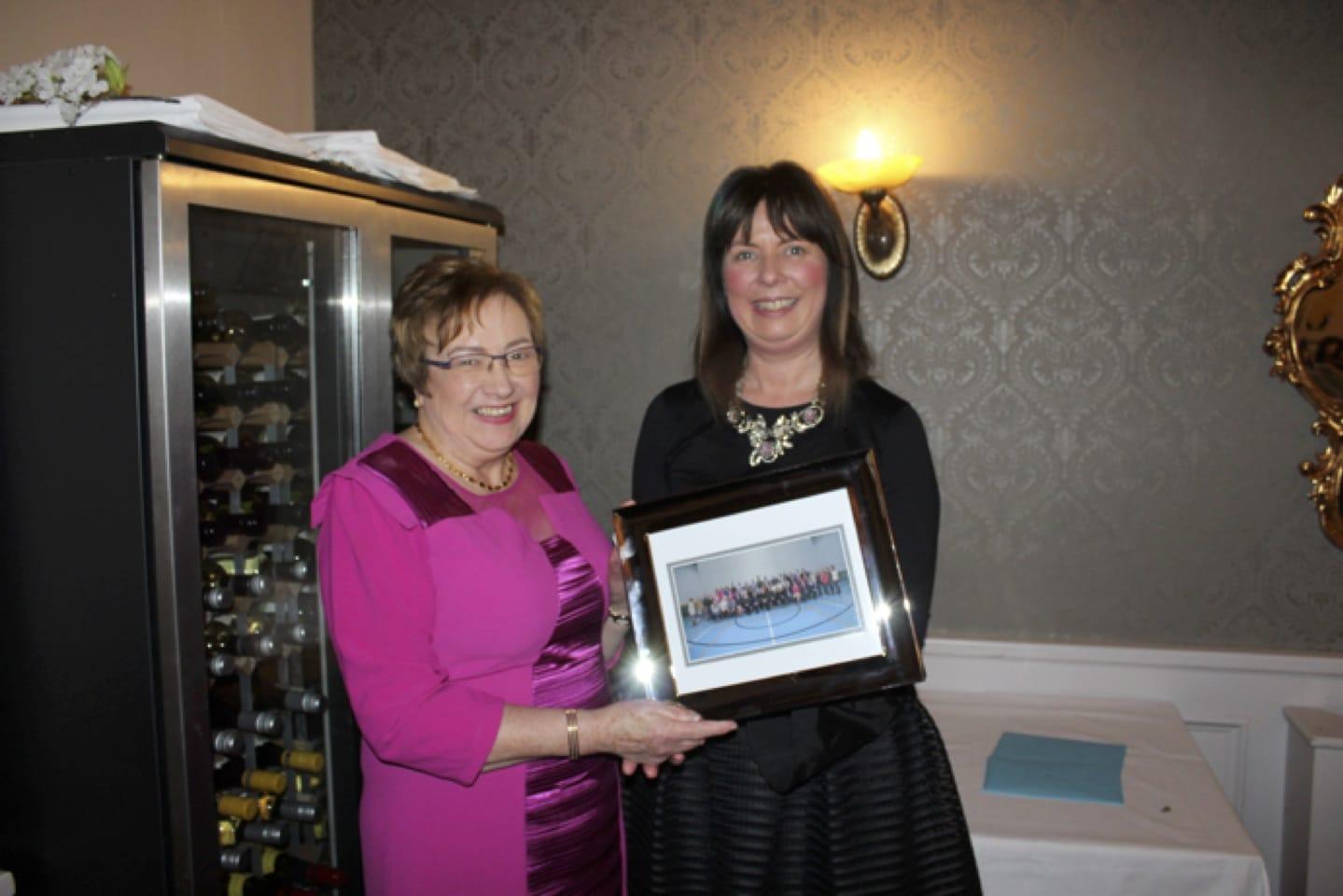 Deputy Principal Liz Cregan presented Carmel Harnett with a staff photo