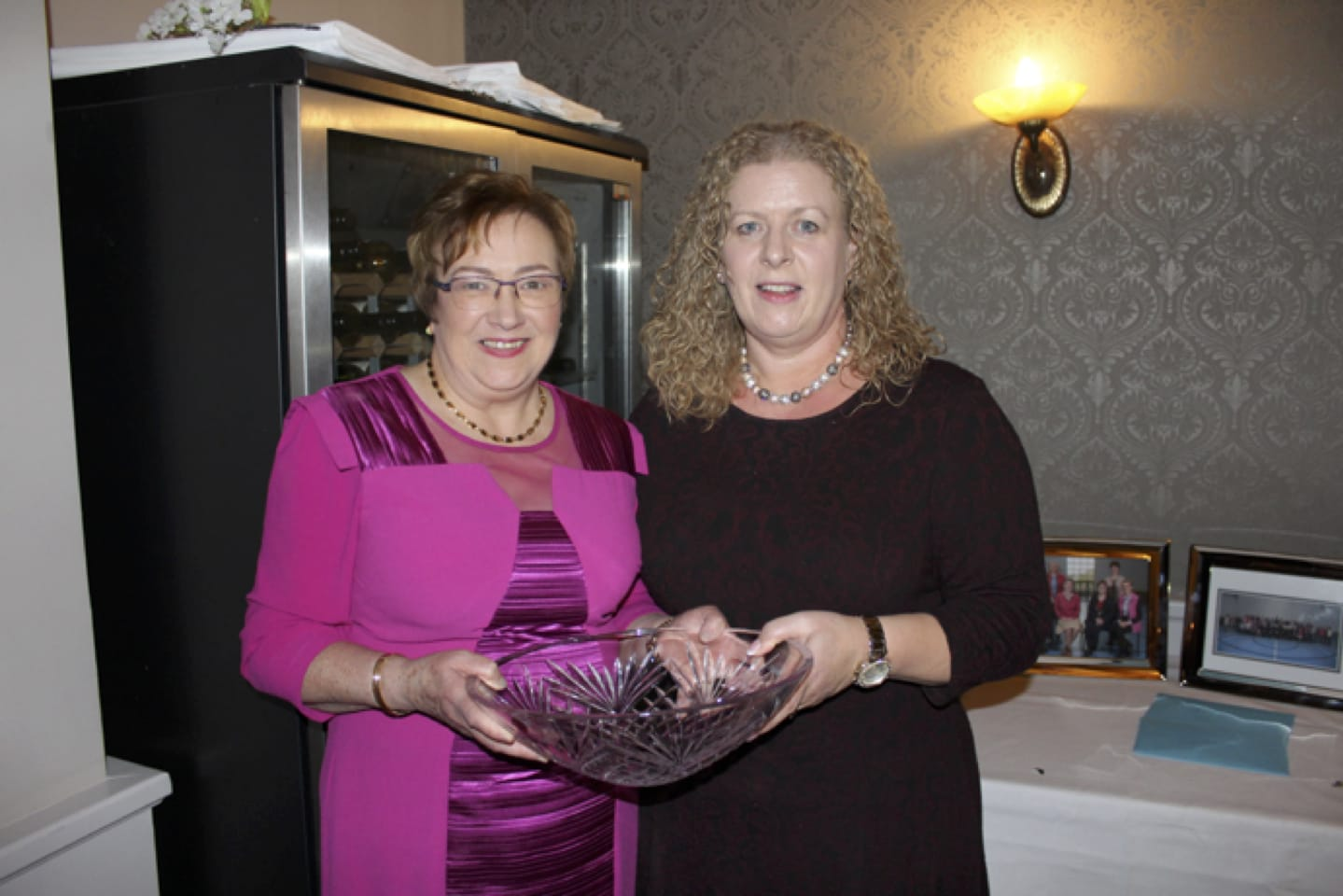 Feb 2017: Carmel Harnett being presented with some Waterford Crystal from Vourneen Gavin Barry at her Retirement Party in the Devon Inn