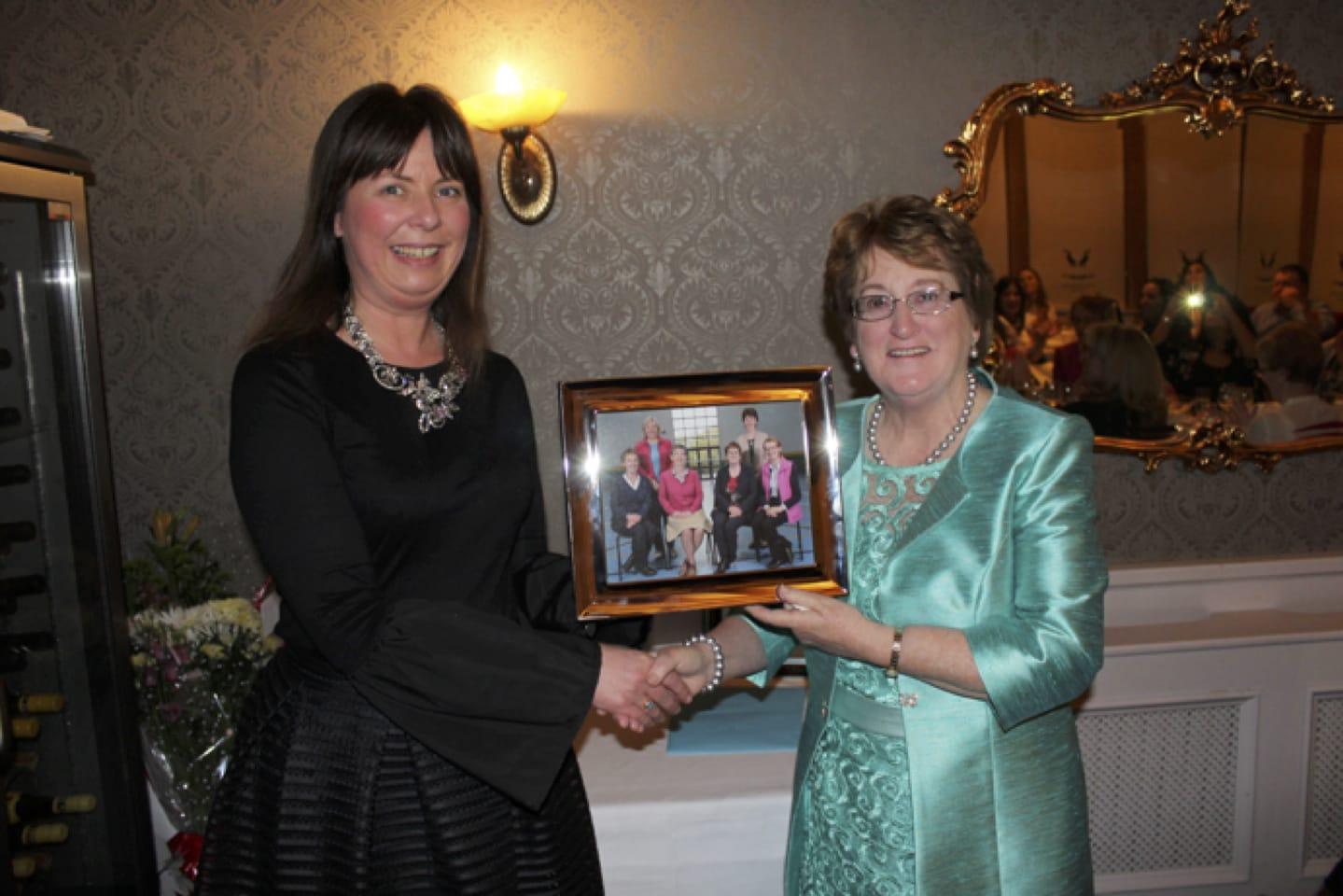 Feb 2017: Deputy Principal Liz Cregan presented Bernie Flynn with a staff photo
