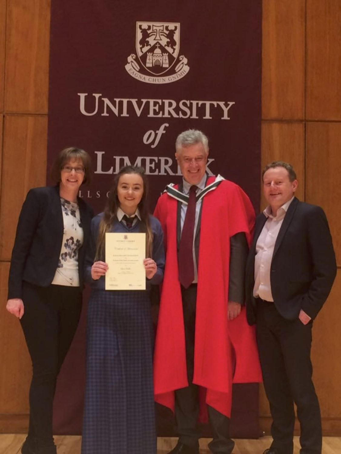 March 2017: Alice Duffy TY student in Desmond College is pictured with her Mam and Dad receiving a Certificate from Philip O Regan, Dean of the Kemmy Business School at the University of Limerick