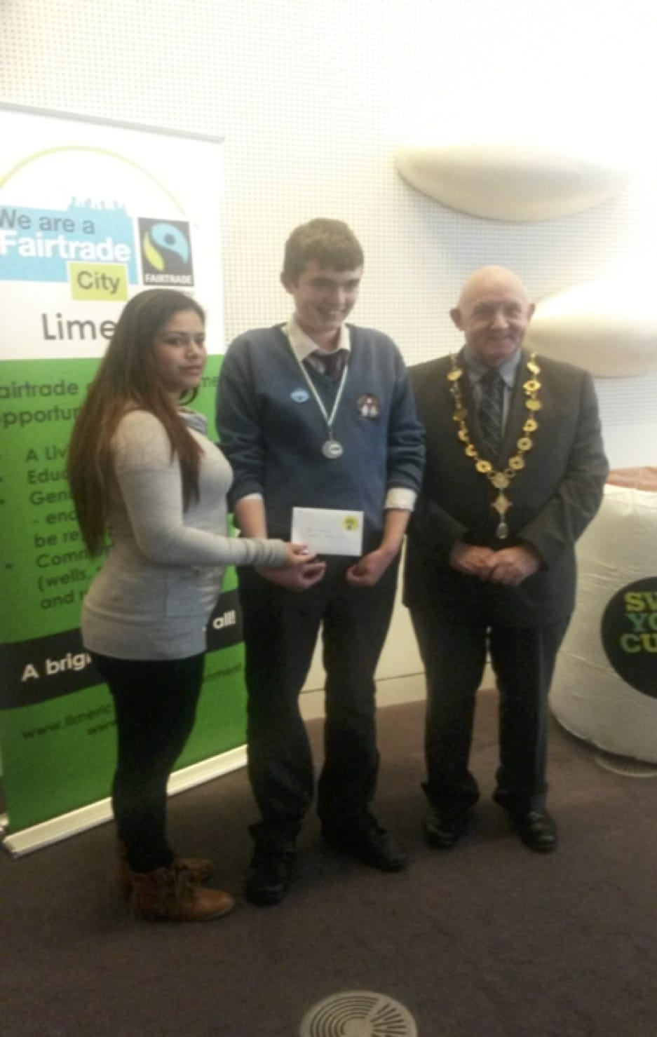 March 2017: Alan Wallace receiving his award from the Mayor of Limerick after winning in the Fair-trade Poster Competition.