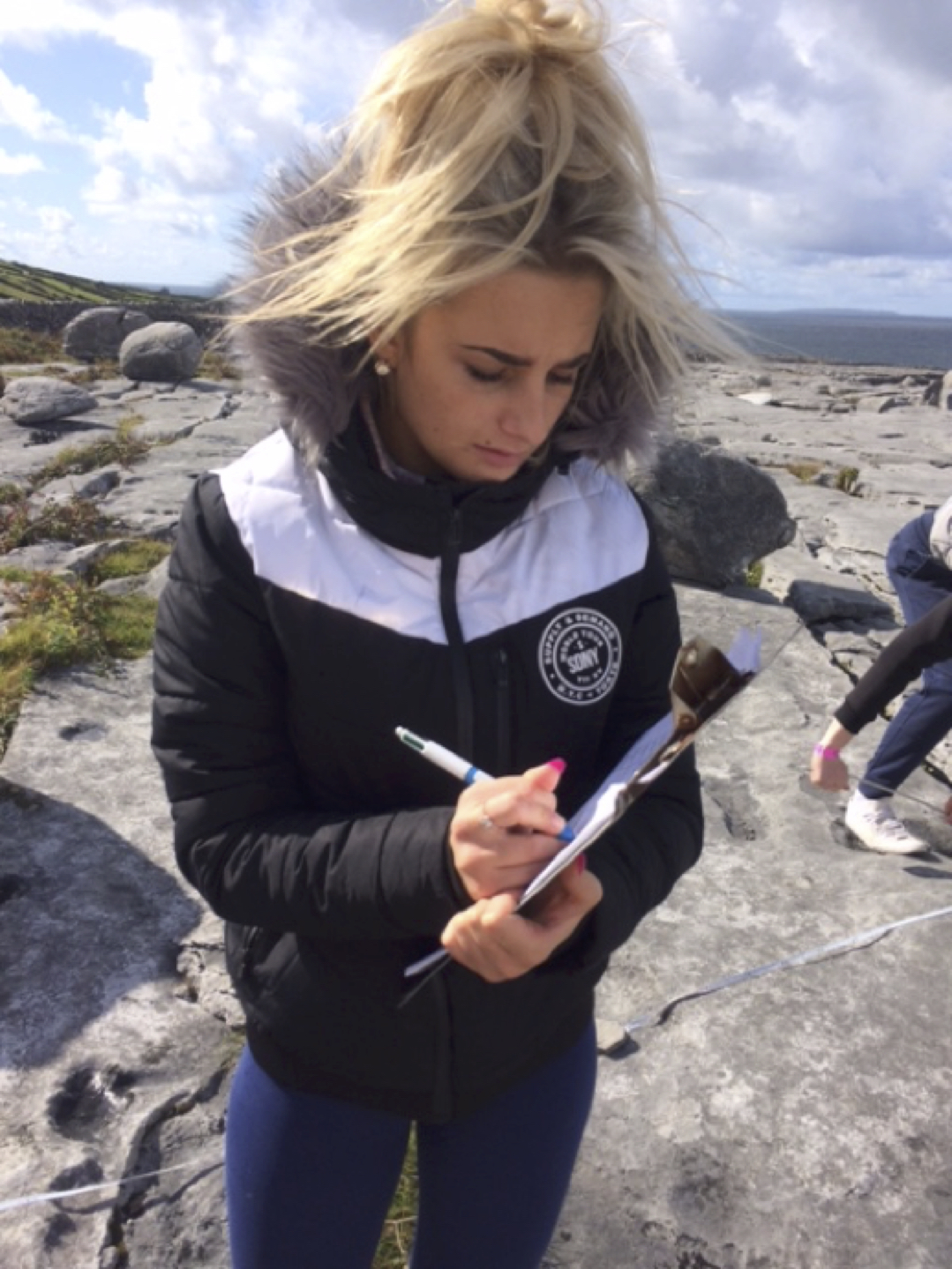 Sept 2017: A Desmond College Geography student recording data from their field trip to the Burren