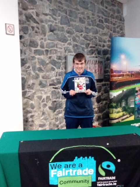 A delighted Alan Wallace with his design of a Christmas card at the FairTrade Christmas competition 2017