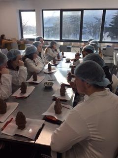 Dec 2017: Students from Desmond College decorating chocolate at the Butlers Chocolate Factory
