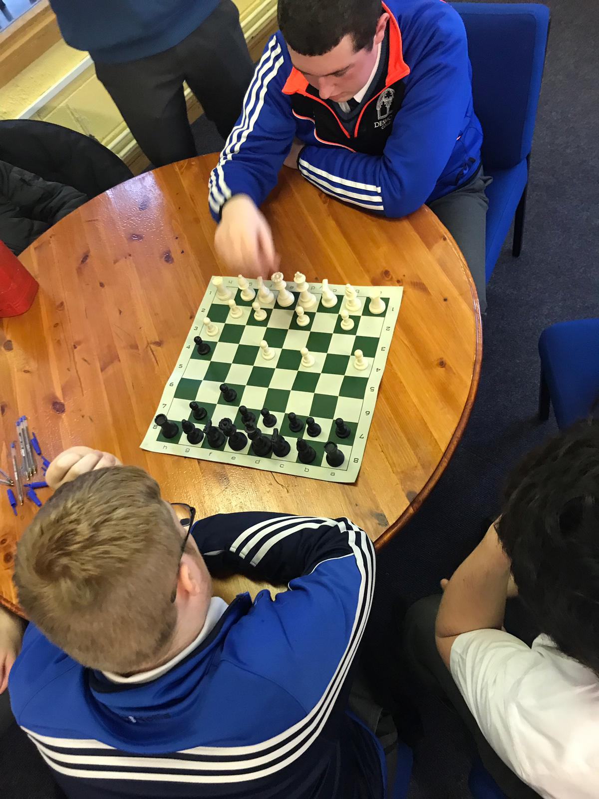 Evan Condon and AJ Dee enjoying a chess game at lunchtime