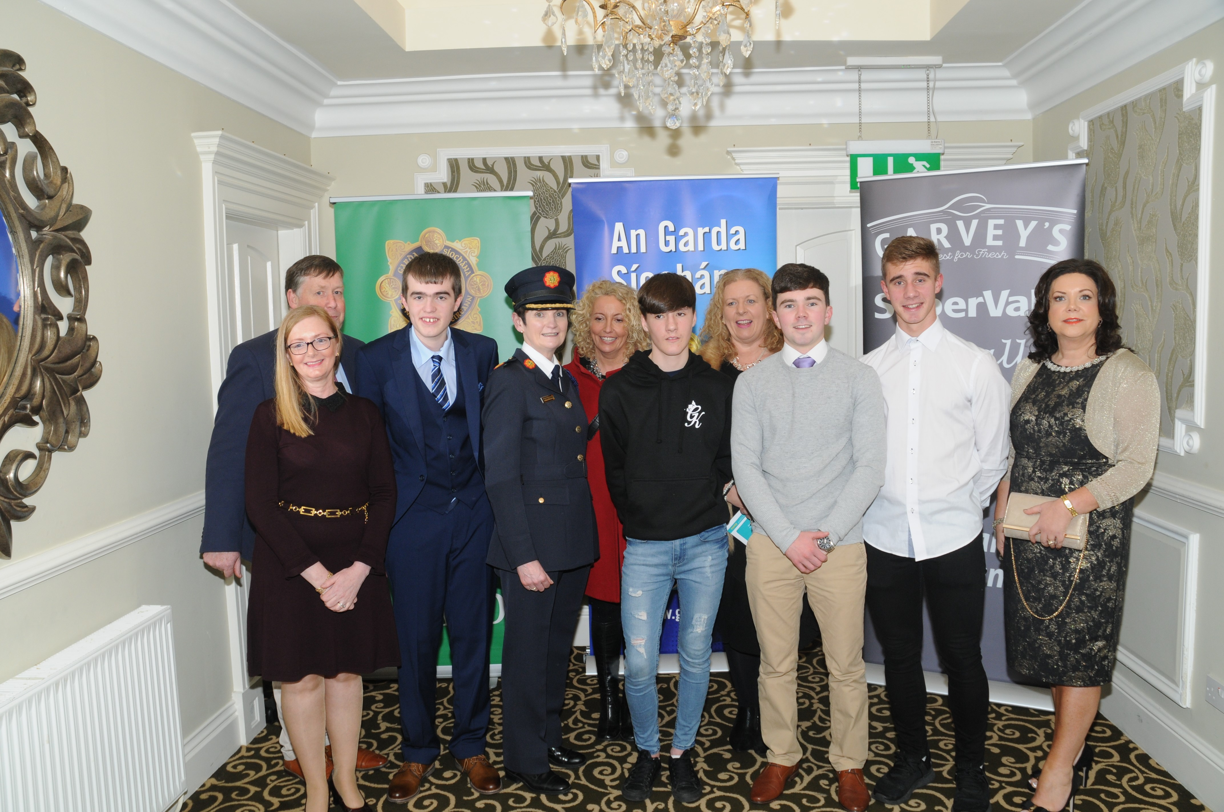 Dec 2018: Ethan Kirwan, Alan Wallace, Thomas Curtin, Dylan Moloney  pictured with their teachers, Year Head and Principal Vourneen Gavin Barry along with members of a An Garda Síochána