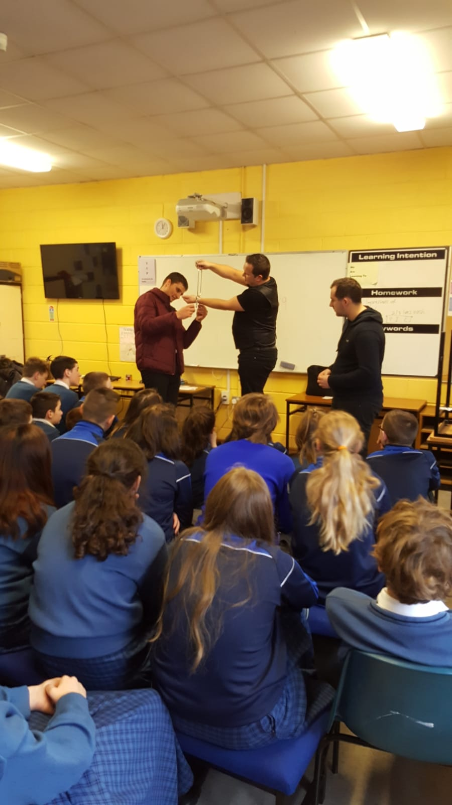Mr Hegarty and Mr O'Leary getting involved in the magic as part of Numeracy Week.