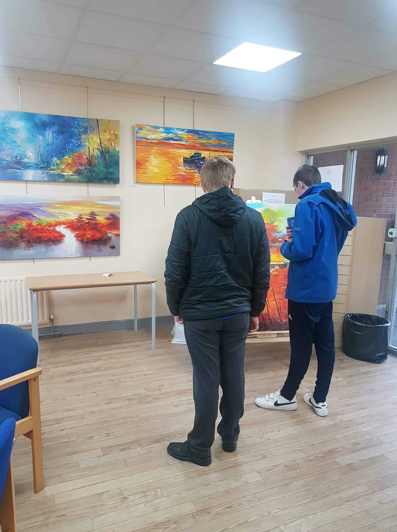 AJ Dee and Alan Wallace admiring the Art Exhibition in the local Library