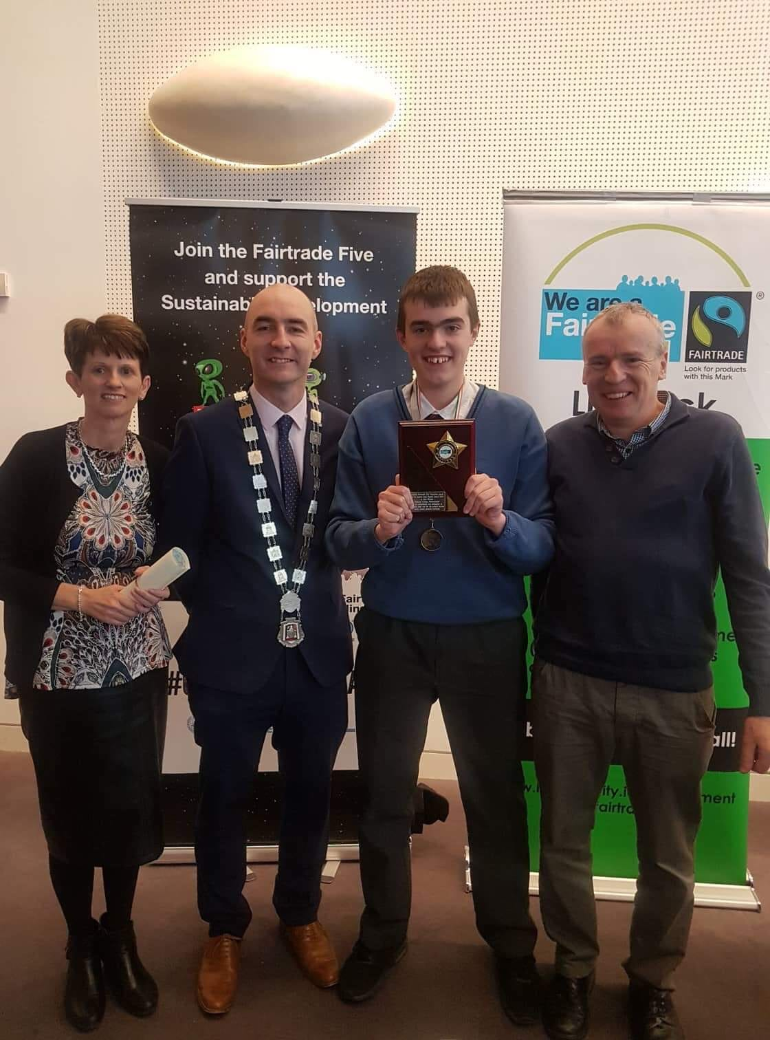 Alan Wallace pictured with his parents and Daniel Butler - Lord Mayor of the Metropolitan District of Limerick after receiving the Sr Rosetta Gray Award from Limerick Fairtrade