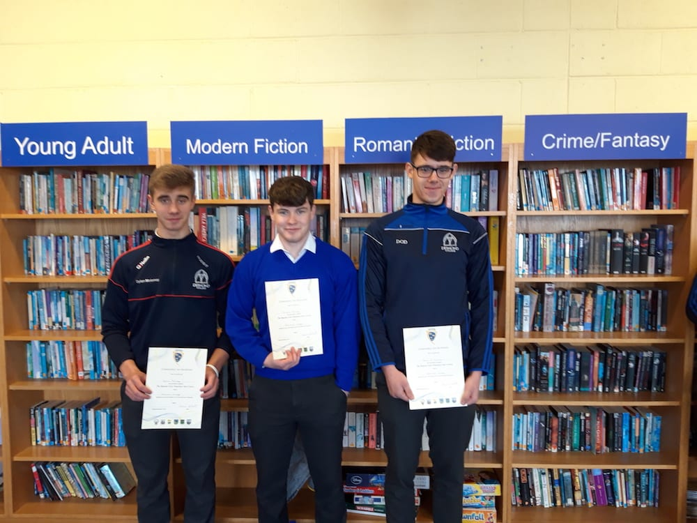 Dylan Moloney, Michéal Murphy and David O'Donovan receiving their certificate for successfully completing the GAA Foundation Coaching Course