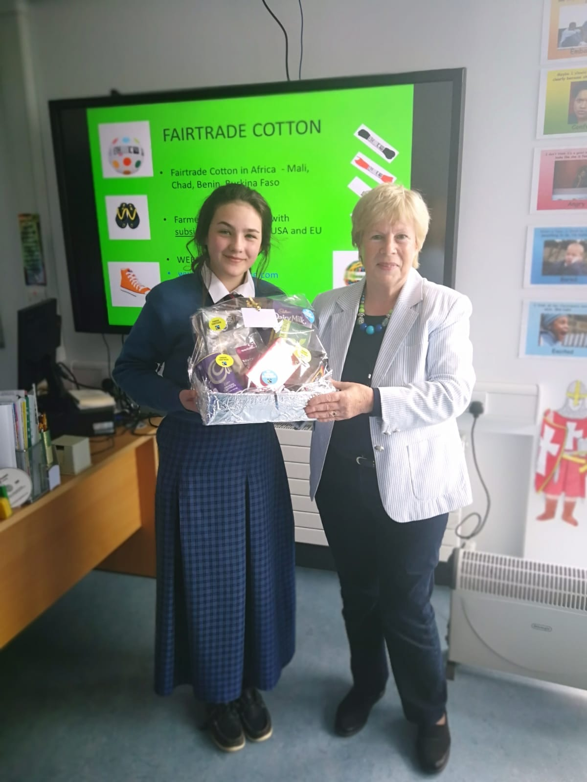 Edel McMahon receiving her hamper from Dolores O'Meara, Chairperson of Limerick Fairtrade