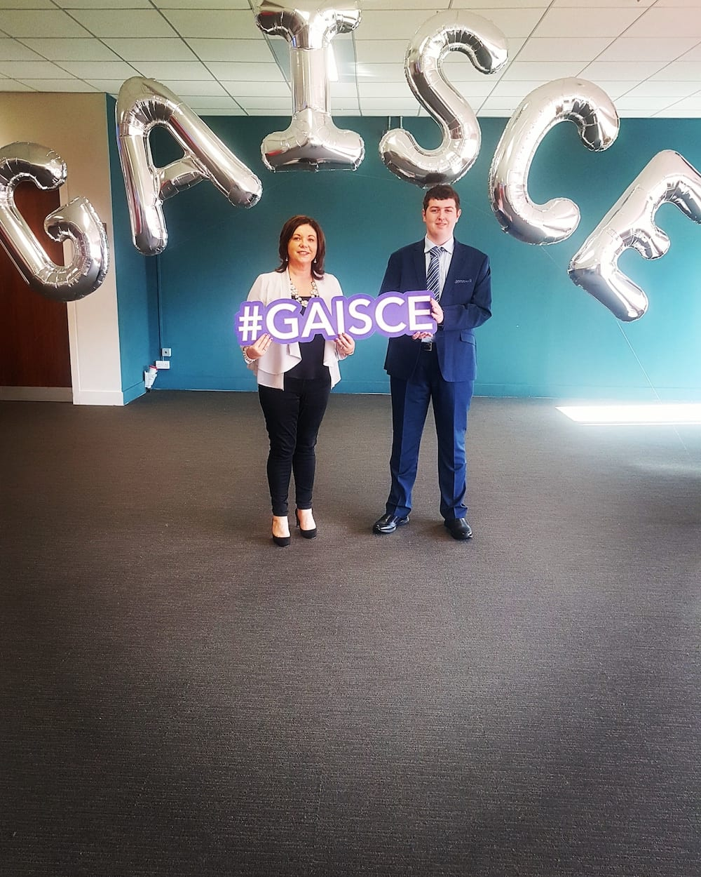 Evan Condon with Ms O'Connor at the Gaisce Award Ceremony where Evan received a silver award