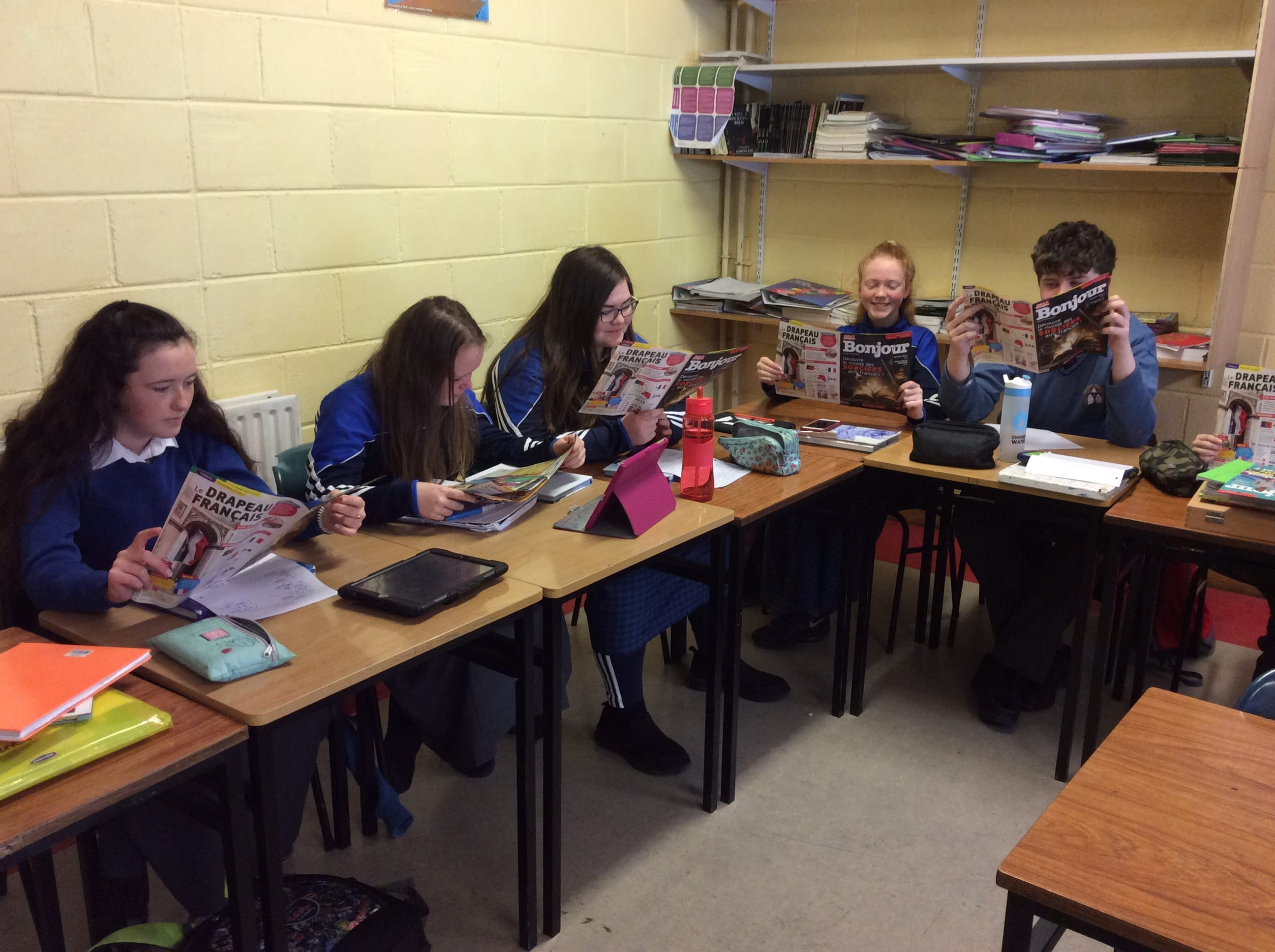 2nd Year French students enjoying reading their French language magazines to develop their literacy and comprehension skills.