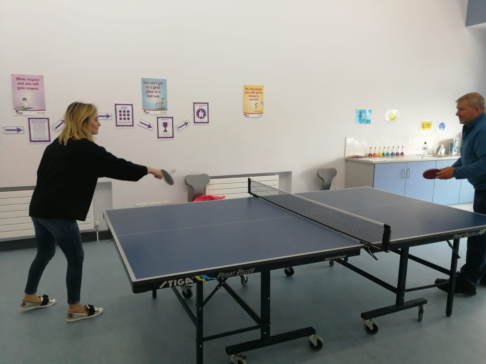 Ms Audrey Cussen taking on John English in a game of table tennis